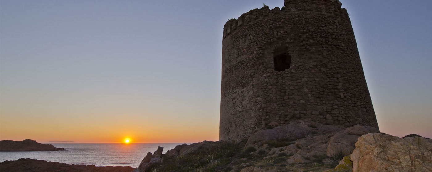 the Spanish Tower of Isola Rossa built around 1595 in the sunset
