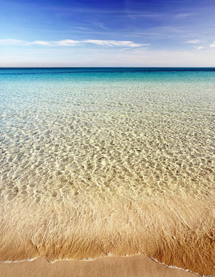 Beaches of fine white sand on Red Island in Sardinia