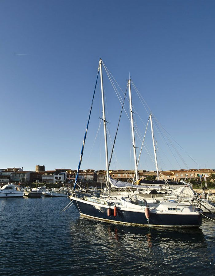 Sailing boat docked near our Sardinia accommodation agency