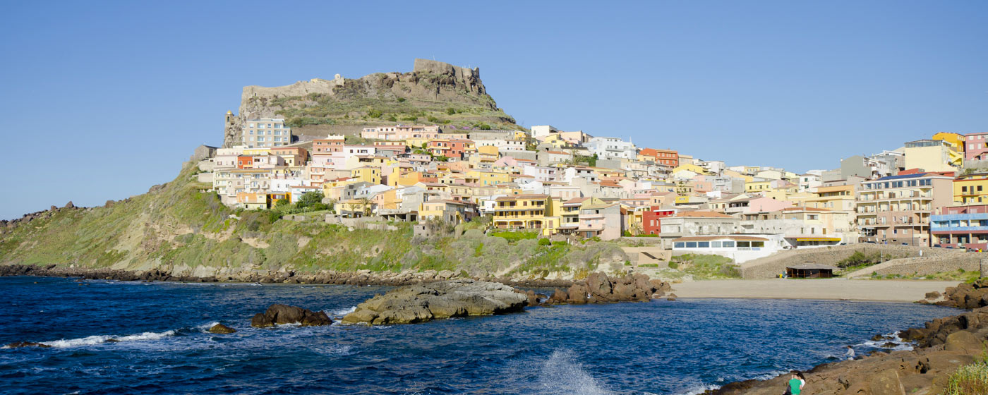 the village of Isola Rossa seen from the sea