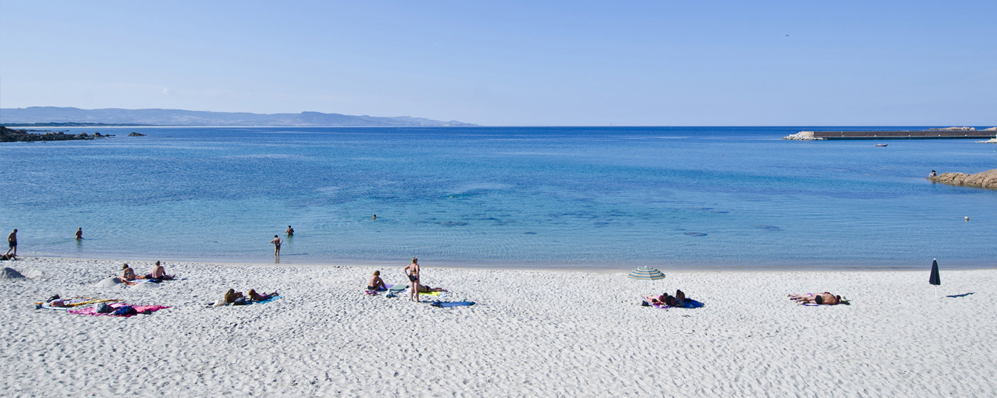 beach at Isola Rossa, white powder sand and clear blue water