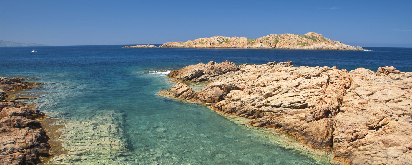 sardinian coast, between rocks and clear sea water